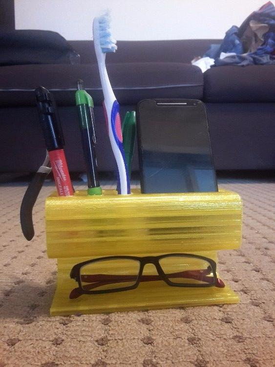 Multipurpose stand for cell-phone, spectacles and Stationery
